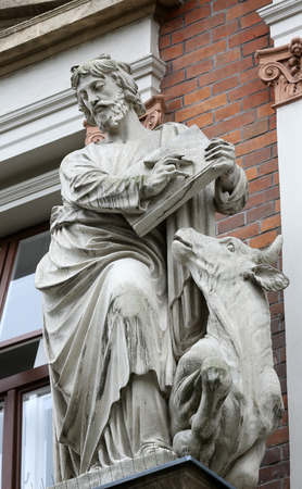 Luke: Saint Luke the Evangelist on the facade of Evangelical School in Vienna, Austria on October 10, 2014.