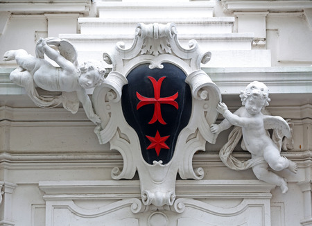 cleric: Detail from the house of the Knights of the Cross with the Red Star on October 10, 2014 in Vienna. The Knights ware a religious order from Bohemia and devoted to medical care.