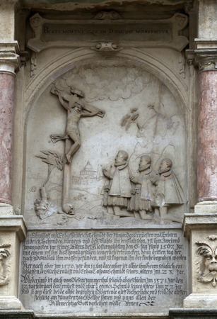An old crucifixion relief sculpture outside St. Stephen Cathedral in Vienna, Austria on October 10, 2014.