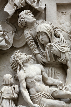 lamentation: Lamentation of Christ Architectural details from the external walls of St Stephen Cathedral in Vienna, Austria on October 10, 2014.