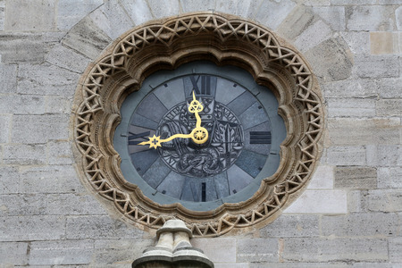 Clock at St Stephens Cathedral in Vienna, Austria on October 10, 2014