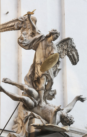messengers of god: Statue of Saint Michael with gold shield and sword in center of Vienna, Austria on October 10, 2014.