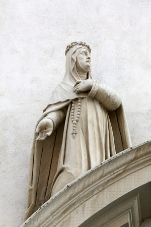 by catherine: Catherine of Siena on the facade of Dominican Church in Vienna, Austria on October 10, 2014. Famous baroque church was completed in 1634.
