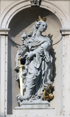 Saint Catherine of Alexandria on baroque Jesuits church. The church was built between 1623 and 1627. in Vienna, Austria on October 10, 2014.