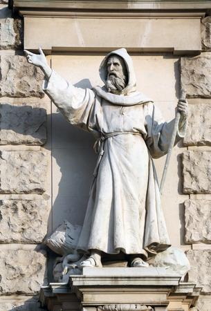 carl: Carl Kundmann: Evangeliser, on the facade of the Neuen Burg on Heldenplatz in Vienna, Austria on October 10, 2014.