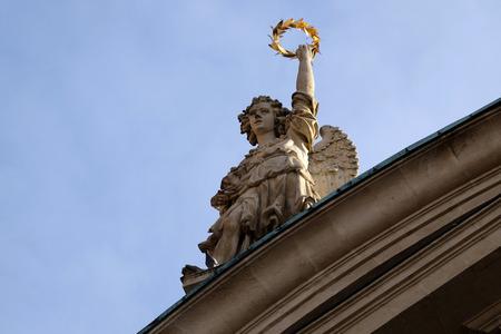 ferdinand: Angel on the portal of St. Catherine church and Mausoleum of Ferdinand II, Graz, Austria on January 10, 2015.