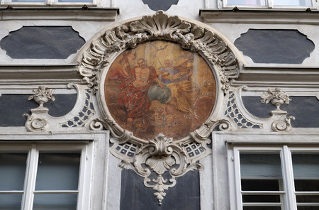 sacred trinity: Holy Trinity fresco painting on the house facade in Graz, Styria, Austria on January 10, 2015.