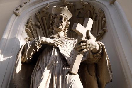 Saint John of Nepomuk on the facade of Parish Church of the Holy Blood in Graz, Styria, Austria on January 10, 2015.