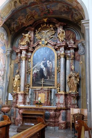 Altar of Saint John of God in Barmherzigenkirche church in Graz, Styria, Austria on January 10, 2015.