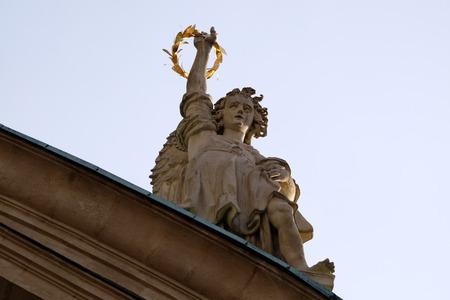 ferdinand: Angel on the portal of St. Catherines church and Mausoleum of Ferdinand II, Graz, Austria on January 10, 2015.