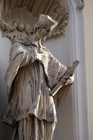 Saint John of Nepomuk on the facade of Parish Church of the Holy Blood in Graz, Styria, Austria on January 10, 2015.
