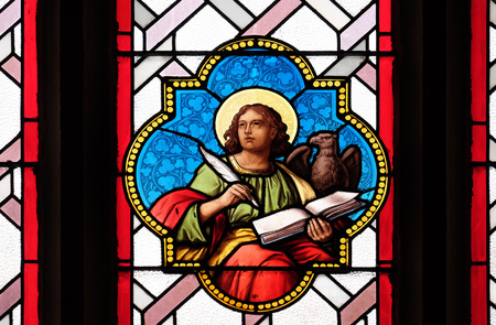 Saint John the Evangelist, stained glass window in Parish Church of the Holy Blood in Graz, Styria, Austria on January 10, 2015.