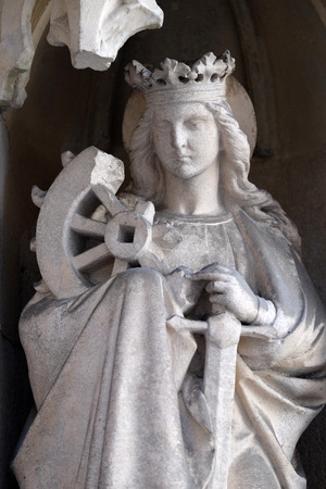 Saint Catherine of Alexandria on the portal of Parish Church of the Holy Blood in Graz, Styria, Austria on January 10, 2015.