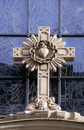 preach: Cross on portal of Parish Church of the Holy Blood in Graz, Styria, Austria on January 10, 2015. Editorial