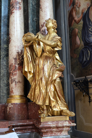 evangelist: Saint John the Evangelist, altar of the Holy Cross, Barmherzigenkirche church in Graz, Styria, Austria on January 10, 2015.