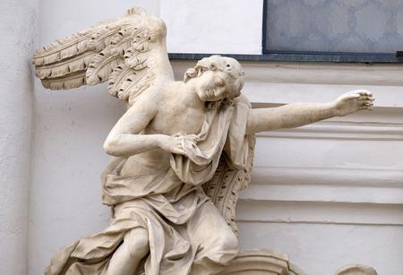 devotional: Angel on the portal of Mariahilf church in Graz, Styria, Austria on January 10, 2015. Stock Photo