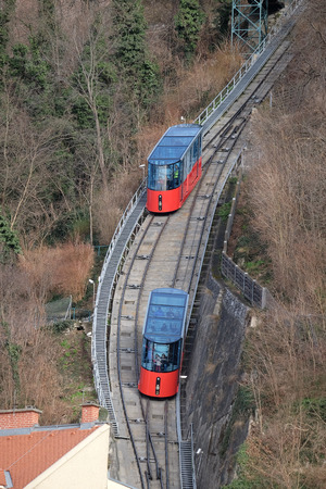 clambering: Modern funicular climbing to Schlossberg and Graz city panoramic view, Austria on January 10, 2015.