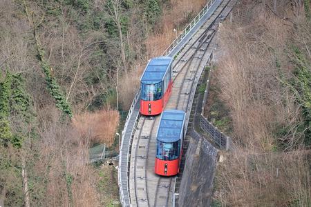 narrow gauge railroad: Modern funicular climbing to Schlossberg and Graz city panoramic view, Austria on January 10, 2015.