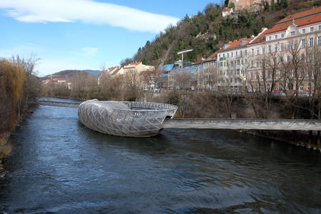 An artificial island on the Mur river. It is a famous landmark and called Murinsel - designed from American architect Vito Acconci and built for the European Cultural Capital 2003 activities now a cafe.