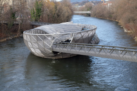 attraktion: An artificial island on the Mur river. It is a famous landmark and called Murinsel - designed from American architect Vito Acconci and built for the European Cultural Capital 2003 activities now a cafe.