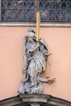 sacred trinity: Archangel Michael on the portal of Dreifaltigkeitskirche ( Holy Trinity ) church in Graz, Styria, Austria on January 10, 2015. Editorial