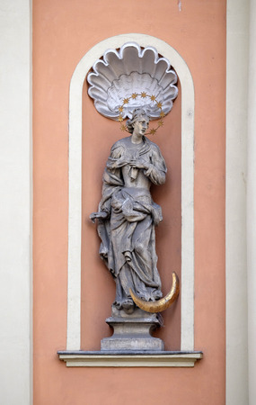 holy trinity: Virgin Mary on the portal of Dreifaltigkeitskirche ( Holy Trinity ) church in Graz, Styria, Austria on January 10, 2015. Stock Photo