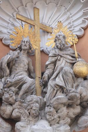 holy trinity: Holy Trinity on the portal of Dreifaltigkeitskirche ( Holy Trinity ) church in Graz, Styria, Austria on January 10, 2015.