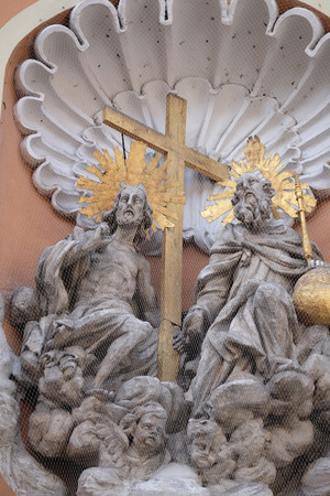 sacred trinity: Holy Trinity on the portal of Dreifaltigkeitskirche ( Holy Trinity ) church in Graz, Styria, Austria on January 10, 2015.