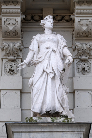 allegorical: Statue of Commerce, allegorical representation, detail of Rathaus Town Hall, Graz, Styria, Austria on January 10, 2015. Editorial