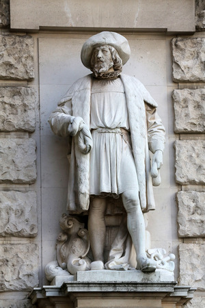 hugo: Hugo Haerdtl: Merchant, on the facade of the Neuen Burg on Heldenplatz in Vienna, Austria on October 10, 2014.