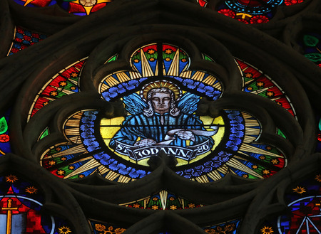 evangelist: Saint John the Evangelist, Stained glass in Votiv Kirche (The Votive Church). It is a neo-Gothic church located on the Ringstrabe in Vienna, Austria on October 10, 2014 Editorial