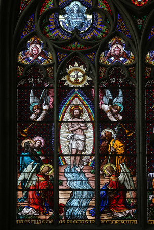Baptism of the Christ, Stained glass in Votiv Kirche (The Votive Church). It is a neo-Gothic church located on the Ringstrabe in Vienna, Austria on October 10, 2014