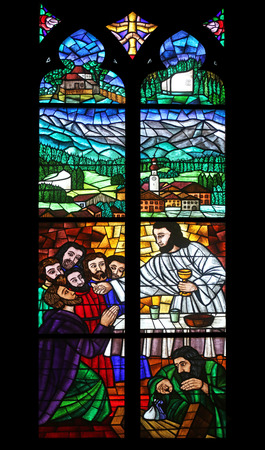 neogothic: Last supper, Stained glass in Votiv Kirche (The Votive Church). It is a neo-Gothic church located on the Ringstrabe in Vienna, Austria on October 10, 2014