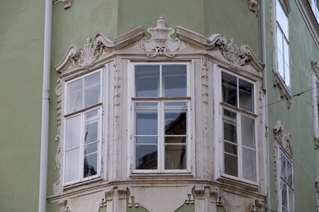 residential housing: Residential housing detail with window pediment in Graz, Styria, Austria on January 10, 2015.