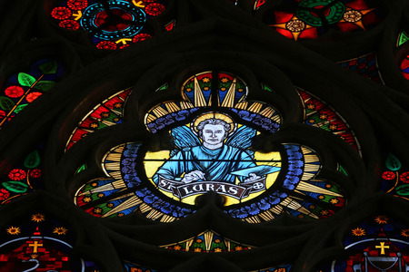 Luke: Saint Luke the Evangelist, Stained glass in Votiv Kirche (The Votive Church). It is a neo-Gothic church located on the Ringstrabe in Vienna, Austria on October 10, 2014