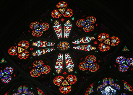 votive: Stained glass in Votiv Kirche (The Votive Church). It is a neo-Gothic church located on the Ringstrabe in Vienna, Austria on October 11, 2014