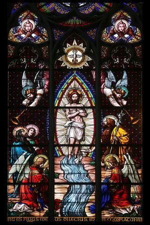 Baptism of the Christ, Stained glass in Votiv Kirche (The Votive Church). It is a neo-Gothic church located on the Ringstrabe in Vienna, Austria on October 11, 2014
