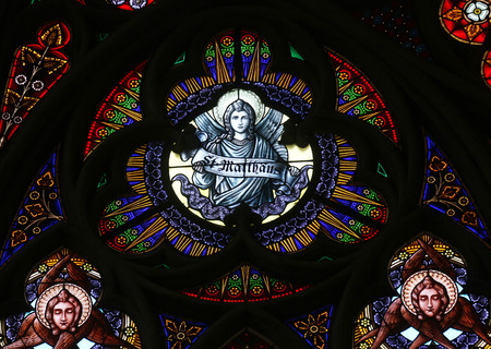 evangelist: Saint Matthew the Evangelist, Stained glass in Votiv Kirche (The Votive Church). It is a neo-Gothic church located on the Ringstrabe in Vienna, Austria on October 11, 2014 Editorial