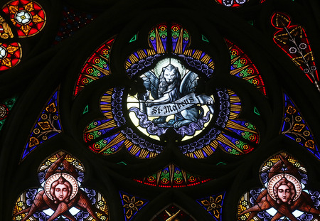 evangelist: Saint Mark the Evangelist, Stained glass in Votiv Kirche (The Votive Church). It is a neo-Gothic church located on the Ringstrabe in Vienna, Austria on October 11, 2014 Editorial