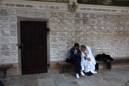 confessing: Priest confessing in pilgrimage Sanctuary Assumption of the Virgin Mary in Marija Bistrica Croatia on October 26 2013 Editorial