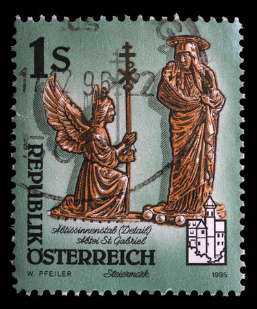 annunciation of mary: stamp printed by Austria, shows figures of archangel Gabriel and Virgin Mary, The Annunciation, Monastery of Admont Stock Photo