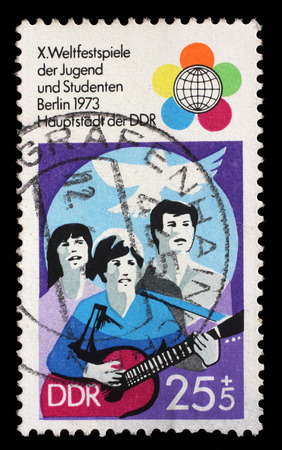 gdr: GDR - CIRCA 1973: a stamp printed in GDR shows Festival Emblem of 10th Festival of Youths and Students, Berlin, circa 1973