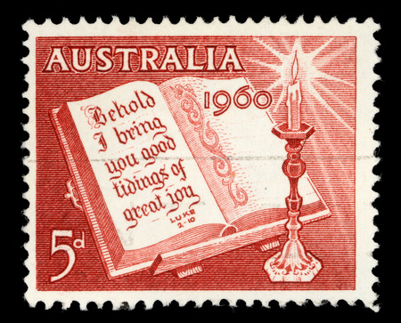 postage stamps: A stamp printed in Australia from the Christmas issue shows Open Bible and Candle