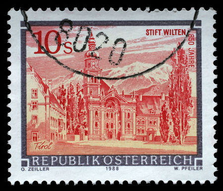 A stamp printed in Austria shows Wilten Abbey in Tirol from the series Monasteries and Abbeys in Austria, circa 1988 新闻类图片