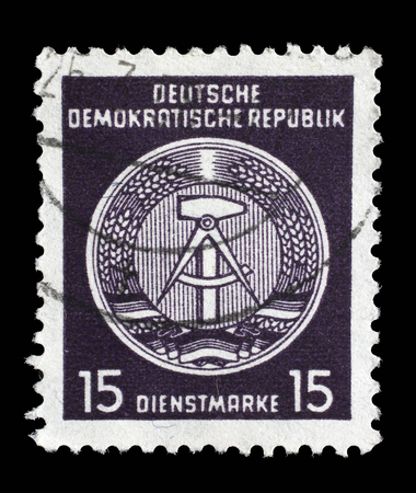 Stamp printed in GDR German Democratic Republic - East Germany shows DDR national coat of arms with inscription Service Stamp, series GDRs national coat of arms, circa 1952