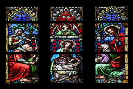 adoration: Nativity Scene, Adoration of the Shepherds, stained glass window in parish church of Saint Mark in Zagreb, Croatia on November 21, 2014 Editorial