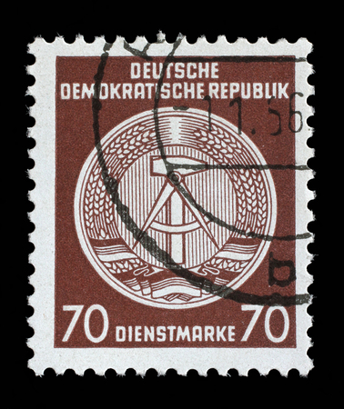 east of germany: Stamp printed in GDR German Democratic Republic - East Germany shows DDR national coat of arms with inscription Service Stamp, series GDRs national coat of arms, circa 1952