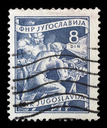 yugoslavia: Stamp printed in Yugoslavia shows miners, domestic economy Series, circa 1952