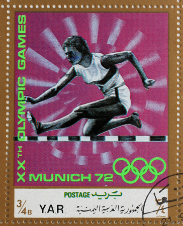 olympics: Stamp printed in Yemen Arab Republic shows steeplechase, Olympics in Munich, circa 1972 Editorial