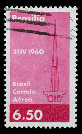 founding: Stamp printed in Brazil with image of Brasilia abstract symbol to commemorate the founding of Brazils capital on 21 April 1960. Stock Photo